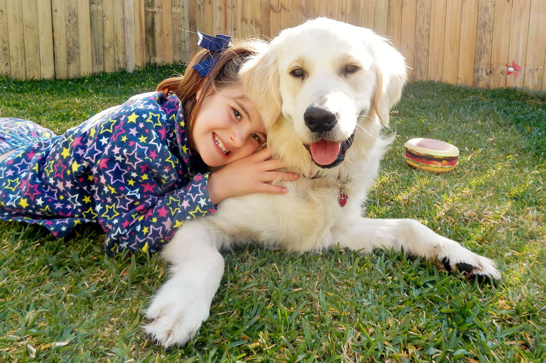 Young girl and her Smart Pups assistance dog